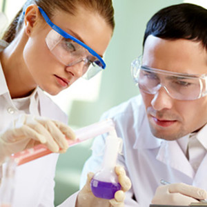A female scientist and a male scientist at work in the lab.