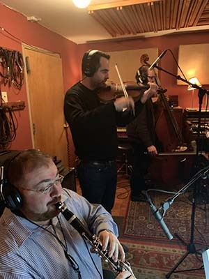 D. Zisl Slepovitch, playing clarinet, and his band mates at recording session in New York City.