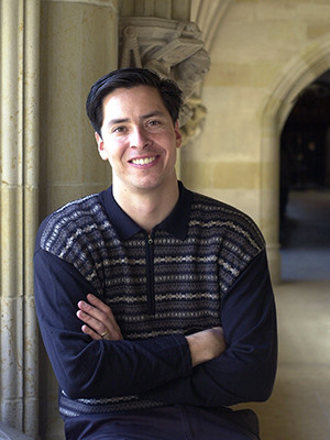 Stephen Pitti leans on a column at Ezra Stiles College.
