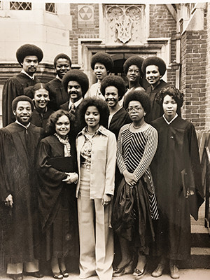 Members of the Yale Class of 1976 pose in front of the Afro-American Cultural Center at Yale.