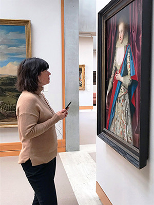 A woman using a mobile app at the Yale Center for British Art.