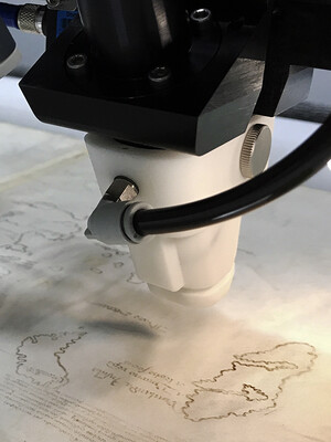 A scanning x-ray fluorescence spectrometer hovering over the Vinland Map.