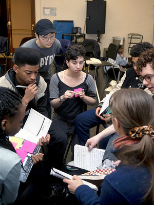 New Voices in Theater founder Madeline Charne and students