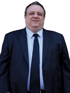 A portrait photograph of a man in a suit, Dragomir Radev.