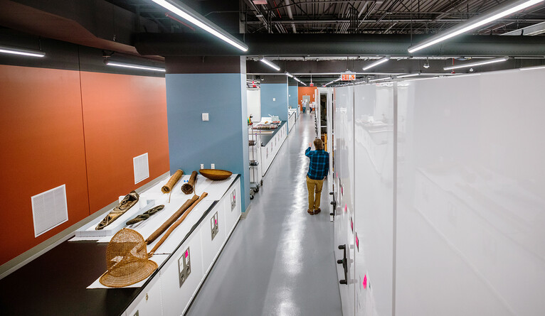 A long hallway lined with storage cabinets.