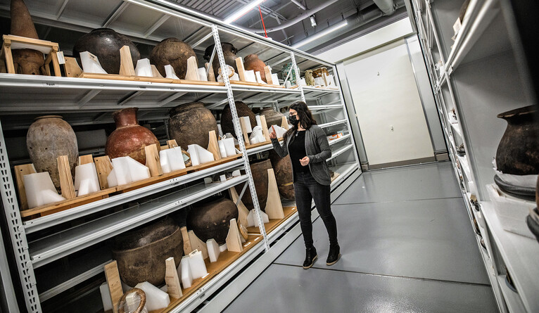 A woman in a museum storage room.