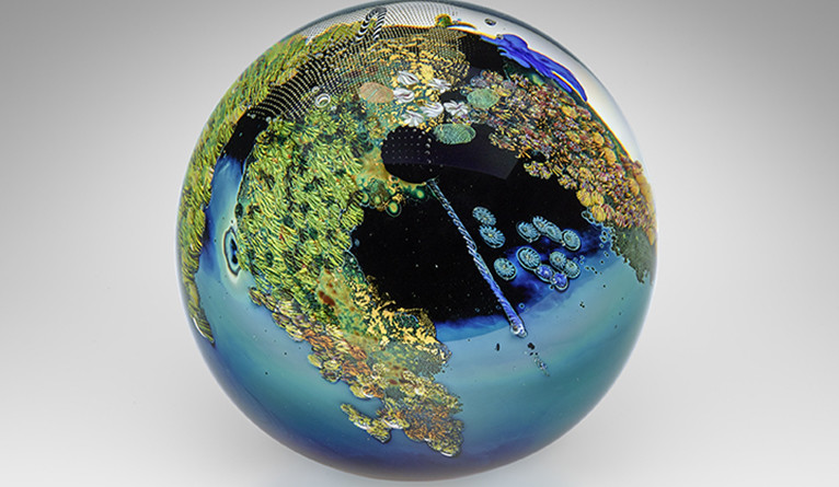 A glass globe made by artist Josh Simpson.