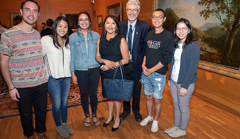 Henderson and Yale School of Public Health Dean Sten Vermund (third from right) pose with students after the event.