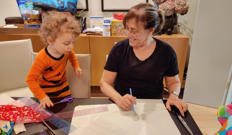 Deborah Bloch, a senior draper in the Costume Shop, is sometimes accompanied by her 18-month-old grandson while making masks.