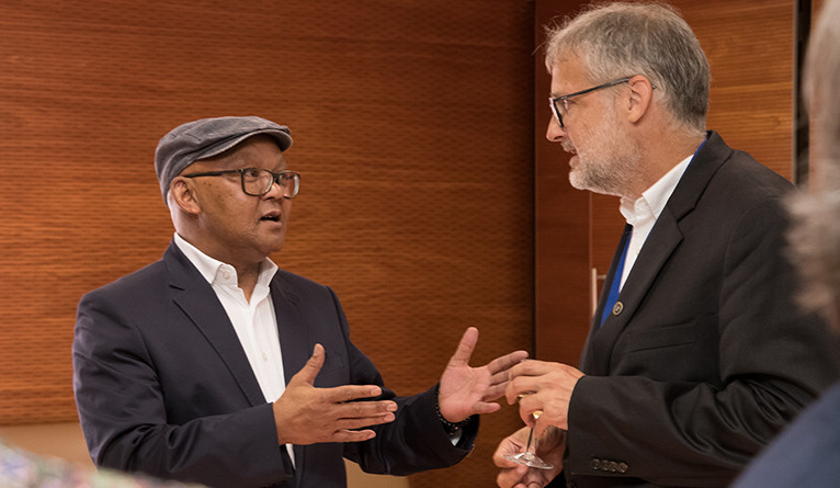 Yale's Stefan Simon engages with with Prof. Norman Duncan, vice-principal of the University of Pretoria.