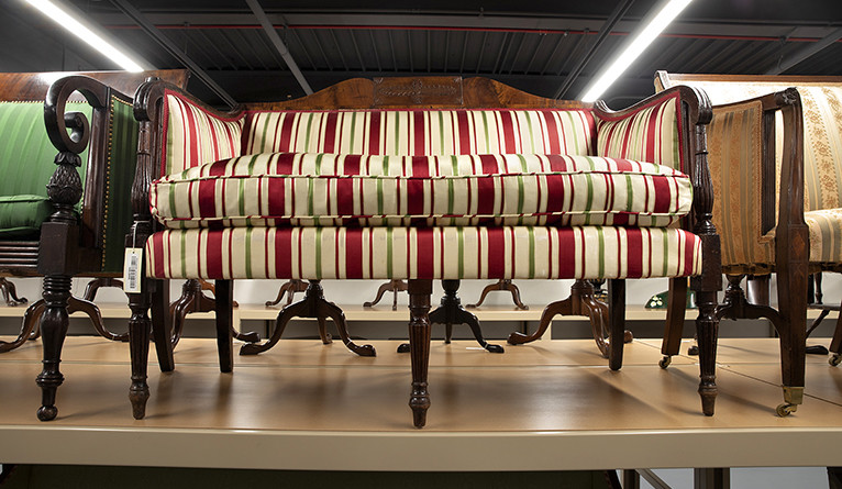 A colorfully striped sofa on display.