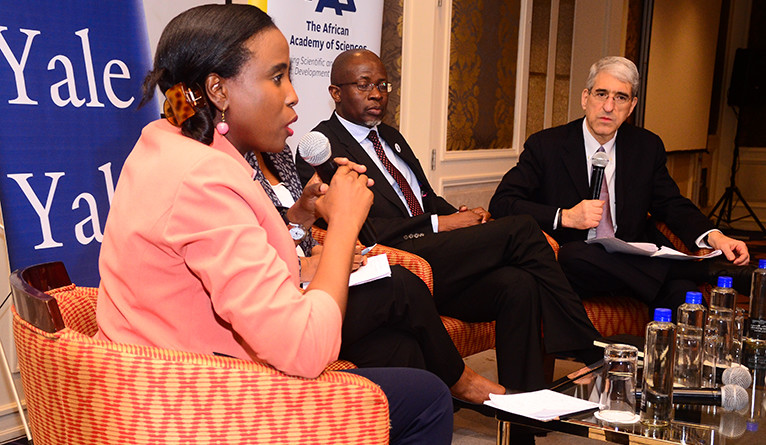 Dr. Catherine Kyobutungi speaks, with Professor Nelson Torto and Yale President Peter Salovey, during a symposium discussion.