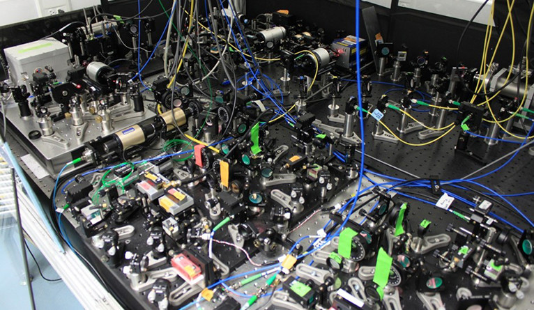 Some of the lasers and optics used in the ACME experiment.