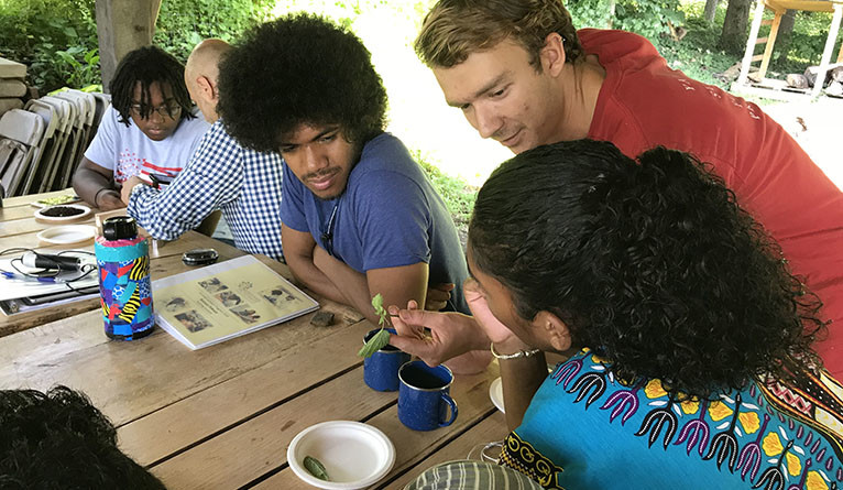 Yale Farm's Adam Houston working with Pathways to Science students.