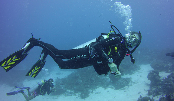 David Agard posing underwater while scuba diving.