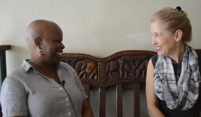 Rose Nanyonga Clarke having a conversation with Ann Kurth