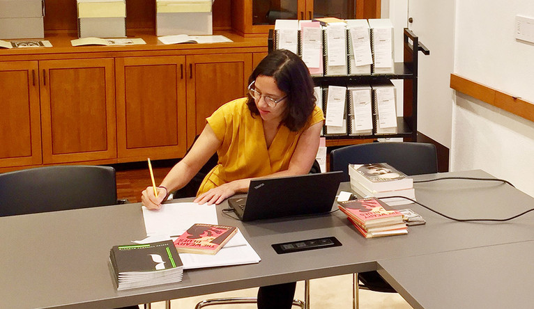 Beinecke curator Melissa Barton working at a desk.