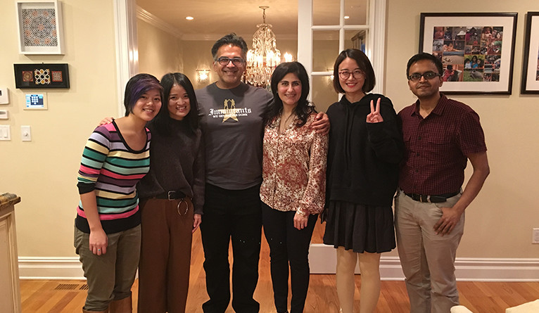 Thanksgiving hosts (center) pose with their four international students during Thanksgiving dinner at their home last year.