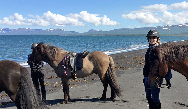 Bilski (right) on the beach during a trip to Iceland
