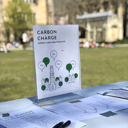 A carbon charge pledge display on Yale's Cross Campus.