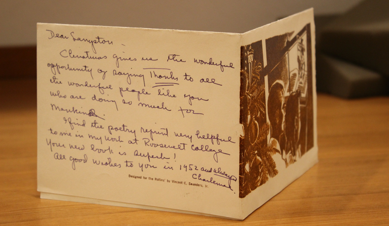 A vintage Christmas card with a handwritten note and an engraved illustration of an African-American boy