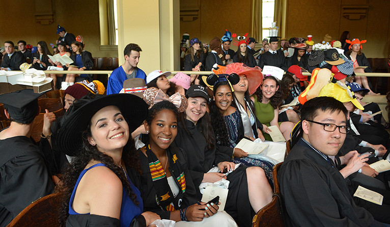 Students posing in silly hats on Class Day