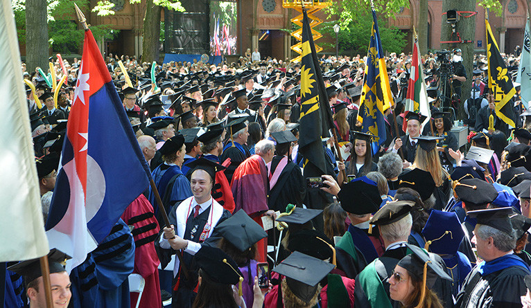 The procession of residential college flag bearers at the Yale University 2018 Commencement ceremony.