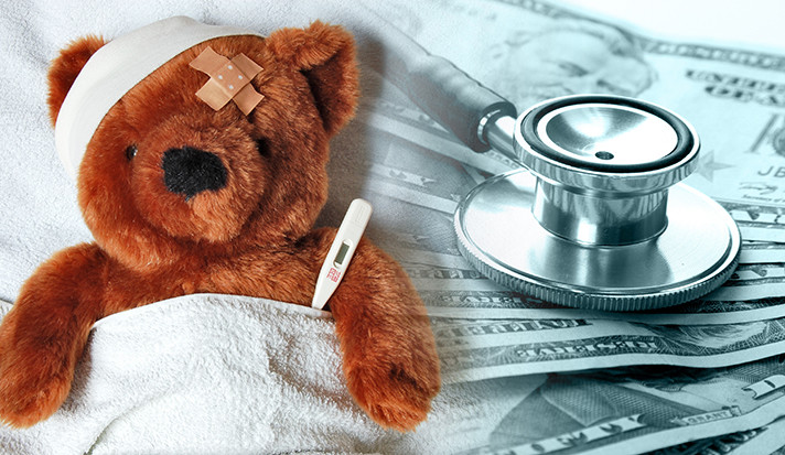 A toy teddy bear wrapped in medical gauze.
