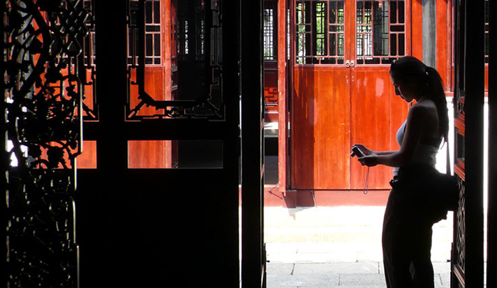 A Yale student, seen in silhouette, explores the local architecture in Suzhou, China.