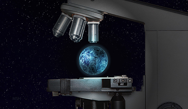 An illustration of a planet underneath a microscope.