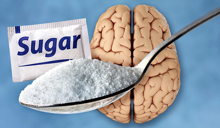 A human brain, a packet of sugar, and a teaspoon of white sugar crystals.