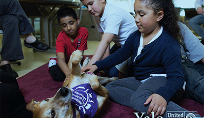 "Marilyn Monteagudo, a student at the John S. Martinez School, pets Nutmeg, a ""Soul Friends"" dog."
