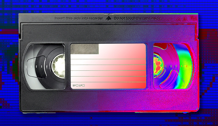 A stylized illustration of a VHS tape with digital background.
