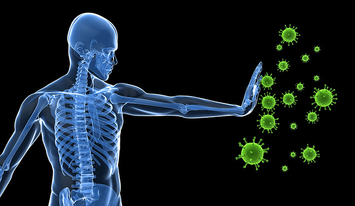 An x-ray man stopping gianr microbes with his hand.