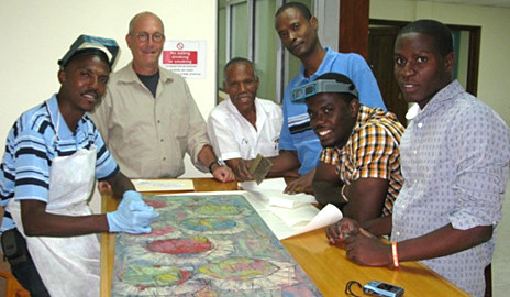 Yale conservator Mark Aronson with some of the members of the team who worked to restore Haitian artworks.