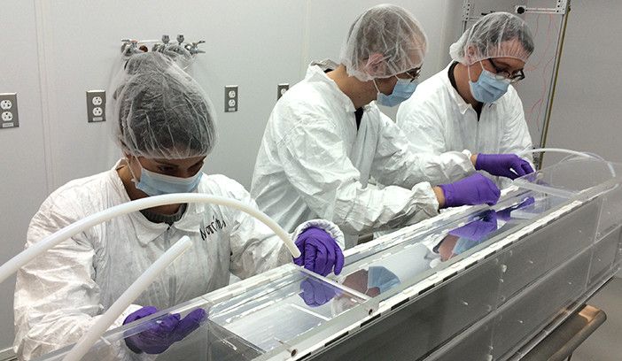 Wright Lab students and scientists assembling an element of an antineutrino detector for PROSPECT.