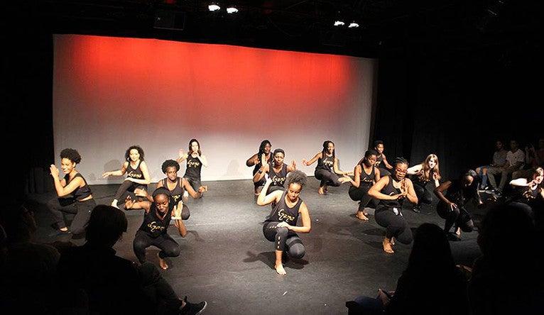 Dzana dancers shown performing onstage