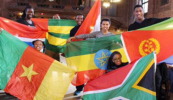 Students holding flags of African countries.