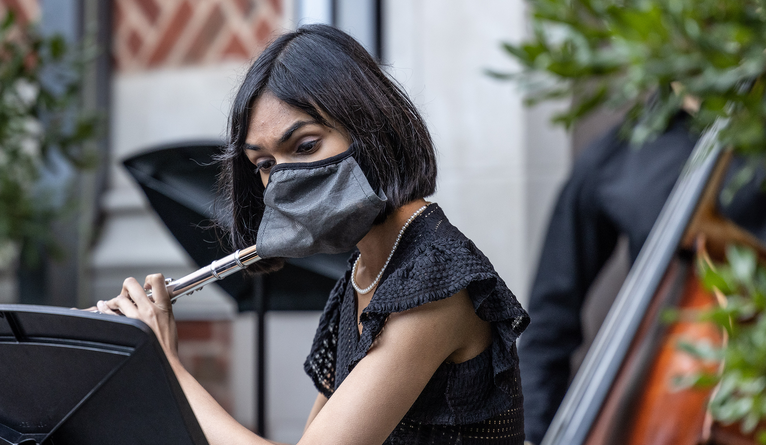 A masked flute player.