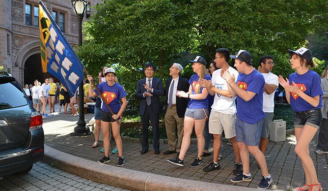 President Peter Salovey and Dean Marvin Chun greet first-year students.