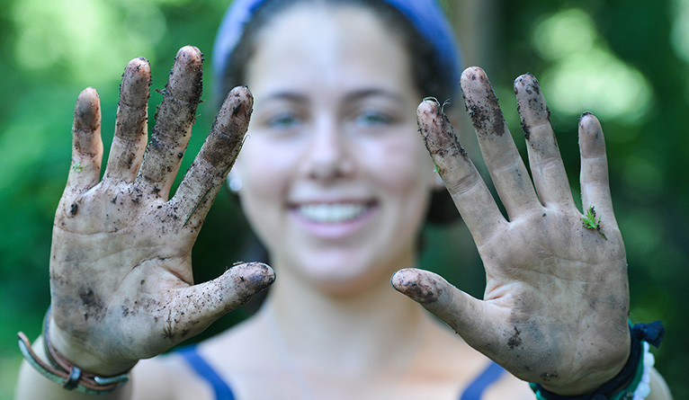 Sophie Lieberman shows off her gardening hands after a day of work at Yale Farm.