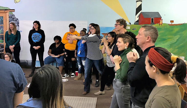 students, teachers, and youth organizers take part in a classroom activity