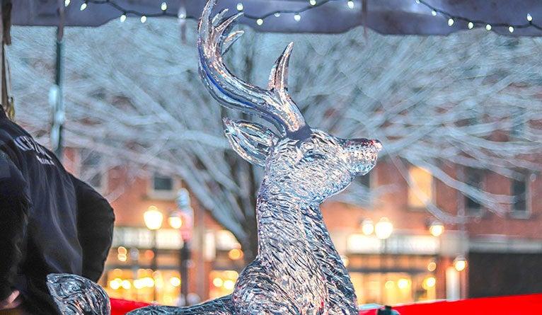 An ice sculpture of a reindeer.