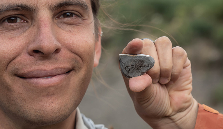 Javier Luque poses with a Callichimaera perplexa fossil.