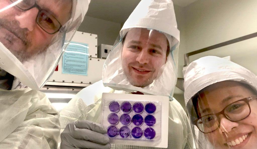 Craig Wilen, Brett Lindenbach, asnd Mia Madel Alfajro in the lab