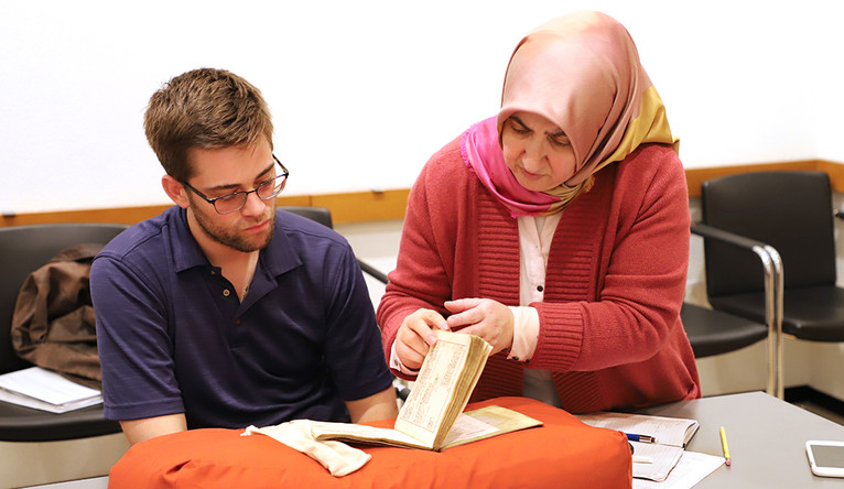 Matthew Dudley, left, and Ozgen Felek study an Ottoman Turkish account book during a class at the Beinecke Library.