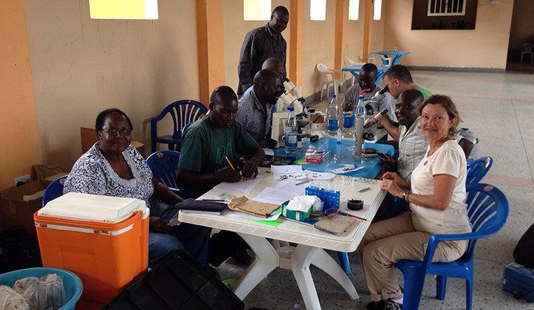 Serap Askoy, Dr. Elizabeth Opiyo, Dr. Brian Weiss with students at a workshop in Uganda
