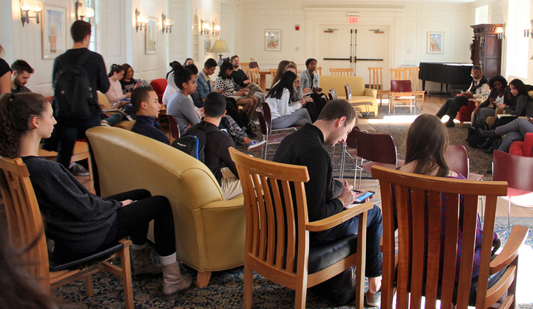 A group of students in a Yale common room.