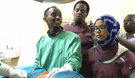 Tanzanian MUHAS radiology residents Drs Ivan Rukundo, Erick Mbuguje and Azza Naif during a procedure.