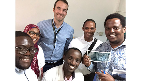 Dr. Frank Minja with radiology residents Drs. Kenedy Foryoung, Azza Naif, Fabian Laage Gaupp, Ivan Rukundo, and Erick Mbuguje.